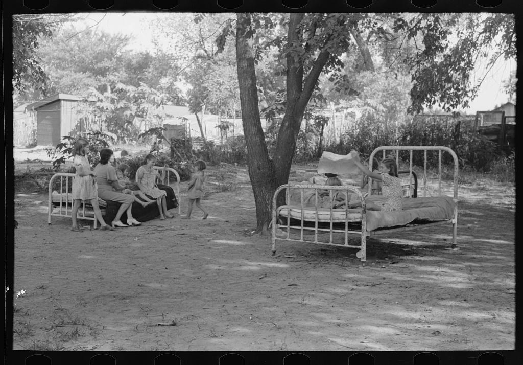 Beds in backyard of family living in community camp, Oklahoma City, Oklahoma