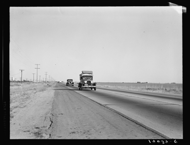 Between Tulare and Fresno. Migrants on the road. California. See general caption