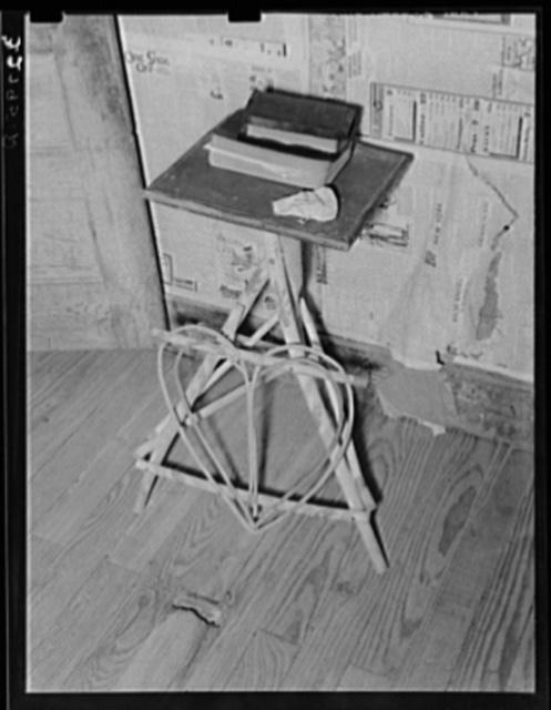 Bibles on wicker table in farm home near Jefferson, Texas