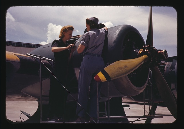 Bowen, a riveter, and Olsen, her supervisor, in the Assembly and Repair Dept. at the Naval Air Base, Corpus Christi, Texas