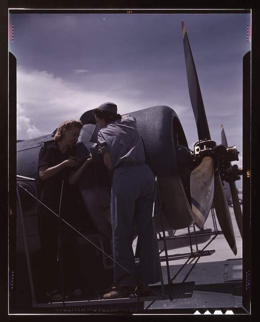 Bowen and Olsen, a riveter and her supervisor, in the Assembly and Repair Dept. at the Naval Air Base, Corpus Christi, Texas