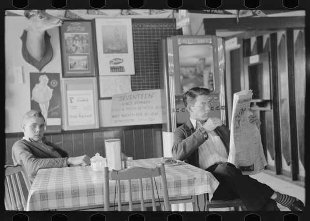 Boys sitting at table in restaurant, Raymondville, Texas