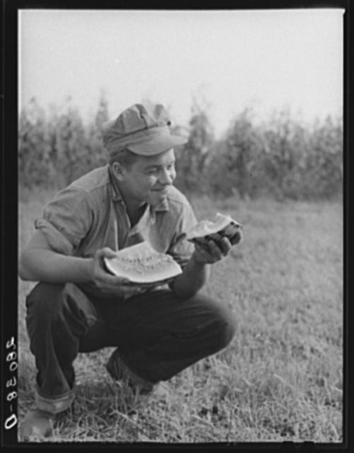 Bud Kimberley eating watermelon. Jasper County, Iowa