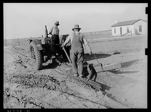 Building lateral irrigation ditch. El Indio, Texas
