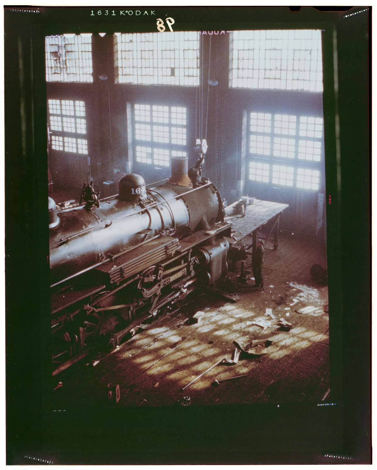 C & NW RR i.e. Chicago and North Western railroad, working on a locomotive at the 40th Street railroad shops, Chicago, Ill