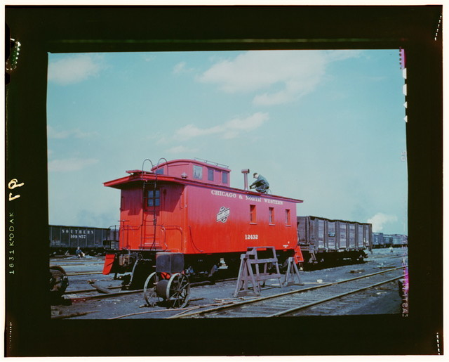 C & NW RR, putting the finishing touches on a rebuilt caboose at the rip tracks at Proviso yard, Chicago, Ill.