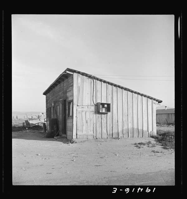 Cabin which rents for ten dollars a month in Arkansawyer's auto camp. Greenfield, California