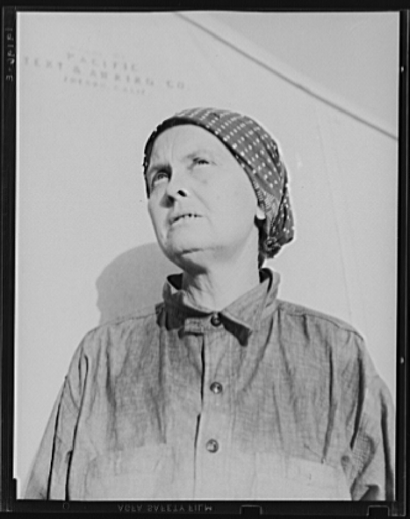 """Calipatria, Imperial Valley. In FSA (Farm Security Administration) emergency migratory labor camp. Left Oklahoma December 11, 1937 with husband and two children and son-in-law. Ex-tenant farmers on third and fourths in cotton. Had fifty dollars when set out. Went to Phoenix, picked cotton and pulled bolls, made eighty cents a day with two people picking bolls. Stayed until school closed. Went to Idaho, picked peas until August, left McCarl with forty dollars """"in hand."""" Went to Cedar City and Parowan, Utah, a distance of 700 miles. Picked peas through September. Went to Hollister, Calipatria. Picked peas through October. Left for Calipatria for early peas which froze. Now receiving FSA food grant and waiting for work to begin. """"Back in Oklahoma we was sinkin.' You work your head off for a crop and then see it burn up. You live in debts that you can never get out of. This isn't a good life, but I say it's a better life than that was."""""""