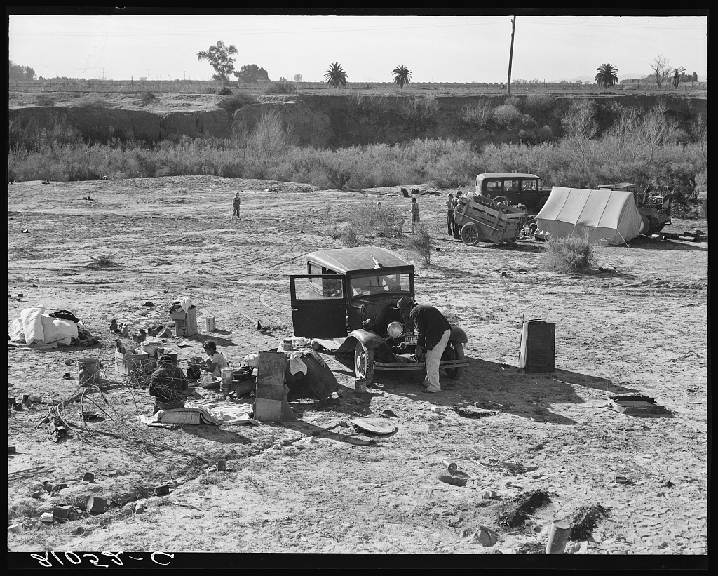 Camped on the flat. Family with five children, left their home in Texas in September 1938. They picked their way across the country in Texas and Arizona cotton. They had just entered California the night before. Near Holtville, Imperial County, California
