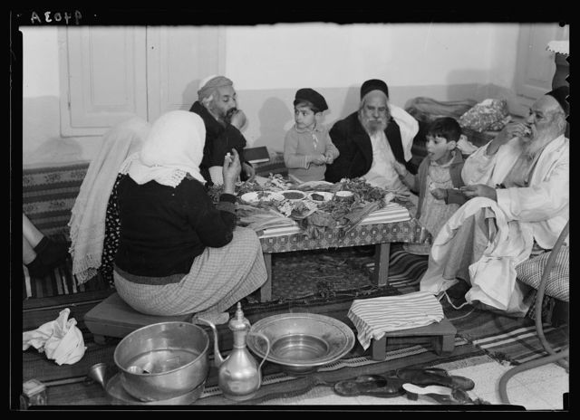 Ceremony of eating the Passover. Yemenite family, April 3, 1939. Eating of the regular meal