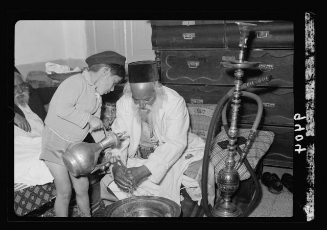 Ceremony of eating the Passover, Yemenite family, April 3, 1939. Washing of the hands