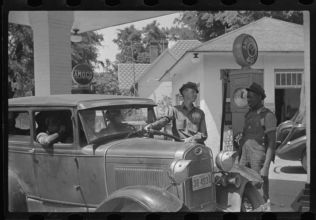 """""""Cherished customer."""" Negro buying gas, near Atlanta, Georgia"""