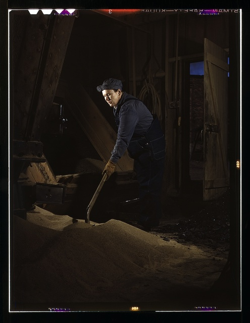 Chicago and North Western R.R., Mrs. Thelma Cuvage, working in the sand house at the roundhouse, Clinton, Iowa. Her job is to see that sand is sifted and cleaned for use in the locomotives. Mrs. Cuvage's husband works as a guard at the Savannah (Ill.) Ordnance plant