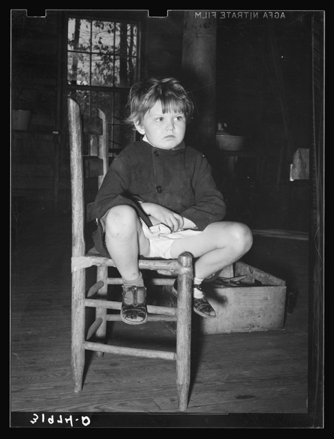 Child of family living in abandoned church near Laurel, Mississippi
