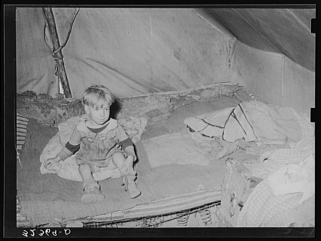 Child of white migrant in tent home. Corpus Christi, Texas