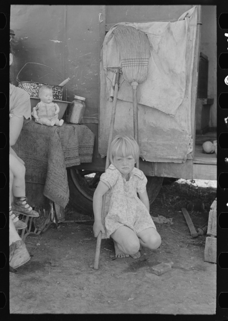 Child of white migrant worker in front of trailer home, Weslaco, Texas