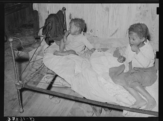 Children of Negro family who do odd jobs on strawberry farm near Hammond, Louisiana
