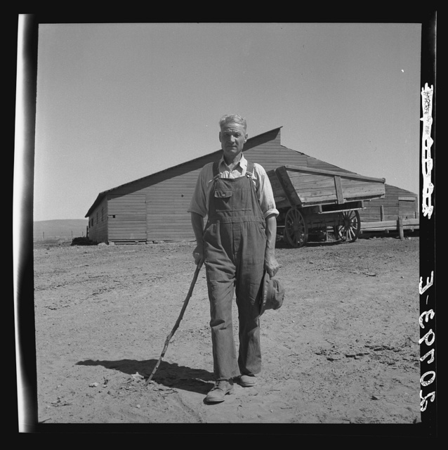 """Chris Ament, on dry land wheat farm of Columbia Basin where he has farmed for thirty three years. """"I won't live to get the benefits of the water, but I hope to be able to see it."""" Washington, Grant County, three miles south of Quincy. See general caption number 35"""