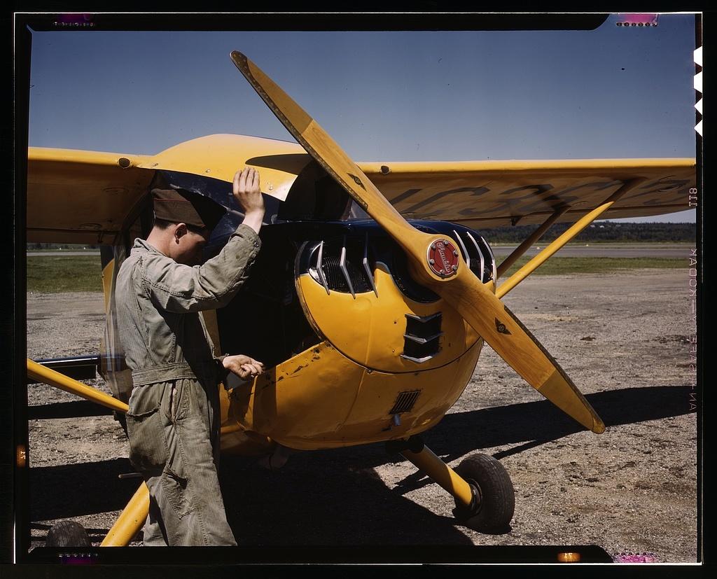 Civil Air Patrol Base, Bar Harbor, Maine. Ground crew making a routine overhaul of a patrol plane, Coastal Patrol #20