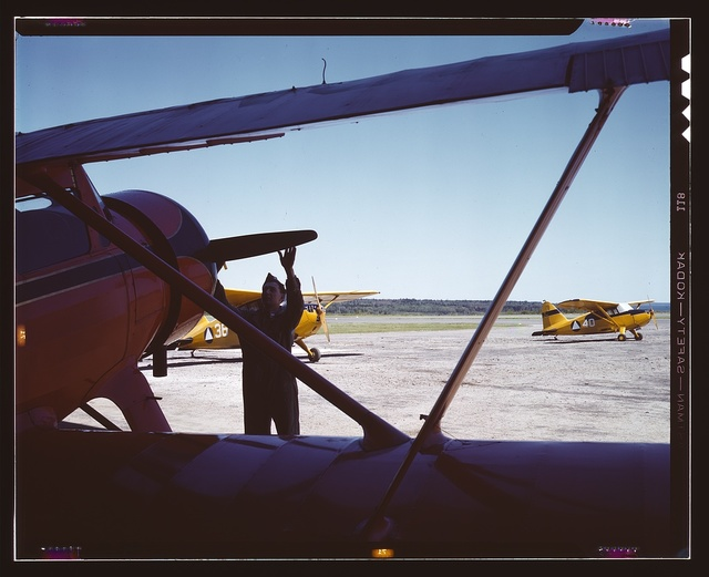 Civil Air Patrol Base, Bar Harbor, Maine. Ground crew making overhaul of a patrol plane. Coastal Patrol #20
