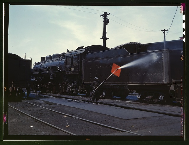 Cleaning an engine near the roundhouse, C. M. St. P. & P. R.R., Bensenville, Ill.