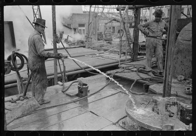 Cleaning off the rotary table with water, Kilgore, Texas