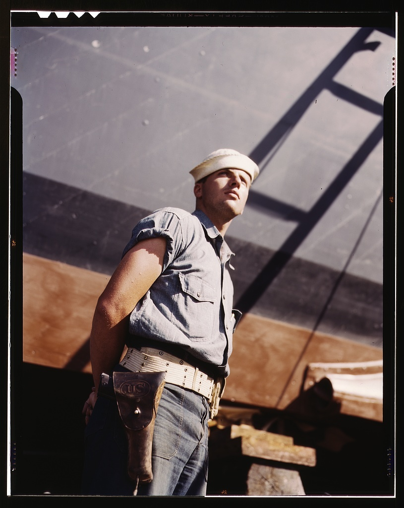 Coast Guardsman standing watch over 78-foot torpedo boat. Continual watch is kept. Higgins Industries, Inc., New Orleans, La.