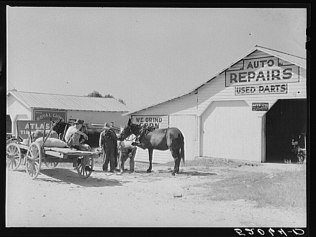 Combination filling station, garage, blacksmith shop, grocery store. Frank Petty, owner of the wagon, has just had his mule shod, his corn ground, purchases some kerosene and is returning home.  R.F.D. Danville, Virginia, Pittsylvania County