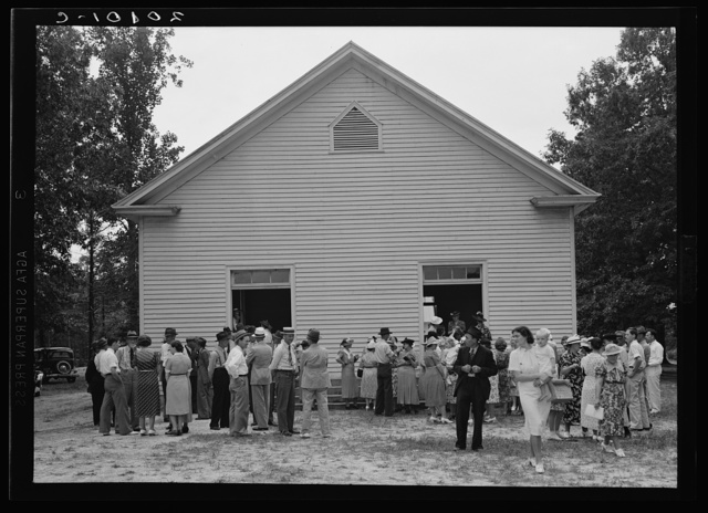 Congregation gathers in groups to talk after services are over. Wheeley's Church, Person County, North Carolina