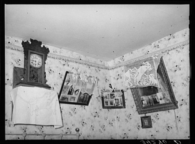 Corner of living room of Spanish-American family near Taos, New Mexico. Notice lace decorations
