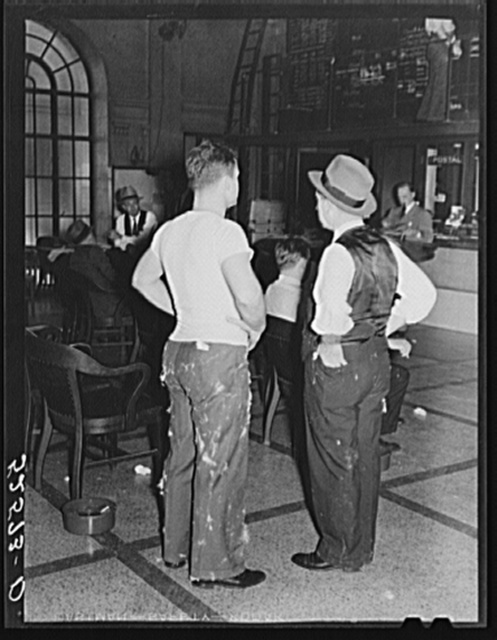 Cotton merchants with cotton lint on suits in Memphis cotton exchange, Tennessee