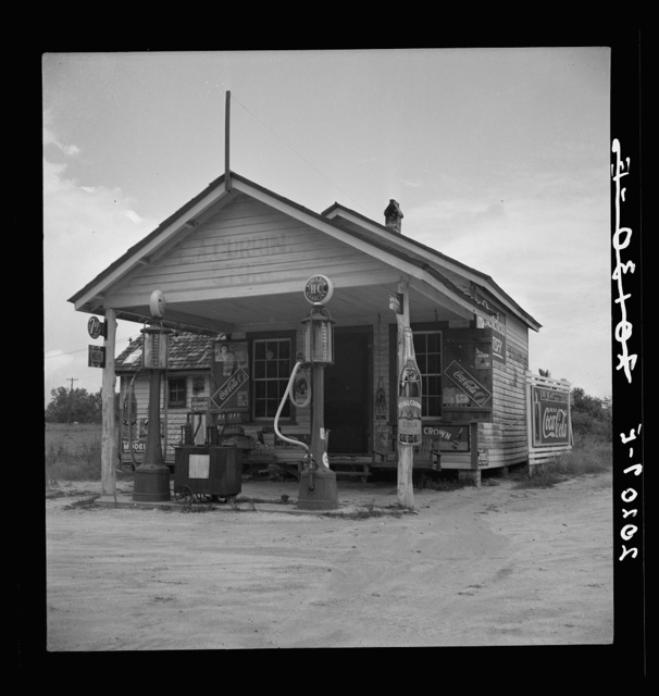 Country filling station owned and operated by tobacco farmer. Such small independent stations have become meeting places and loafing spots for neighborhood farmers in their off times. Granville County, North Carolina