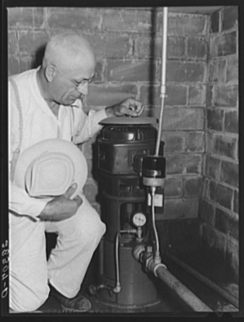 County agent with electric waterpump made possibly by Rural Electrification Adiministration. Grundy County, Iowa