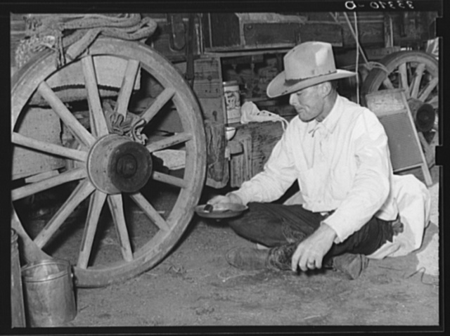Cowboy eating dinner by the chuck wagon on SMS Ranch near Spur