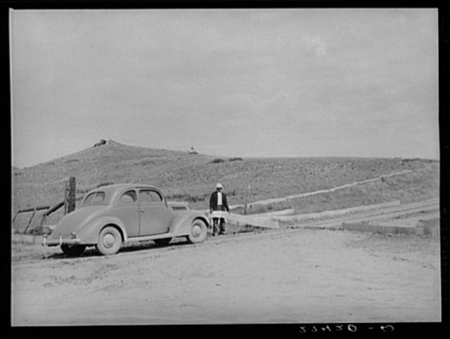 Cricket fence barricades a road. Big Horn County, Montana