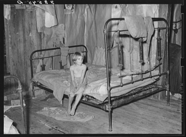 Daughter of agricultural day laborer in bedroom of home in McIntosh County, Oklahoma