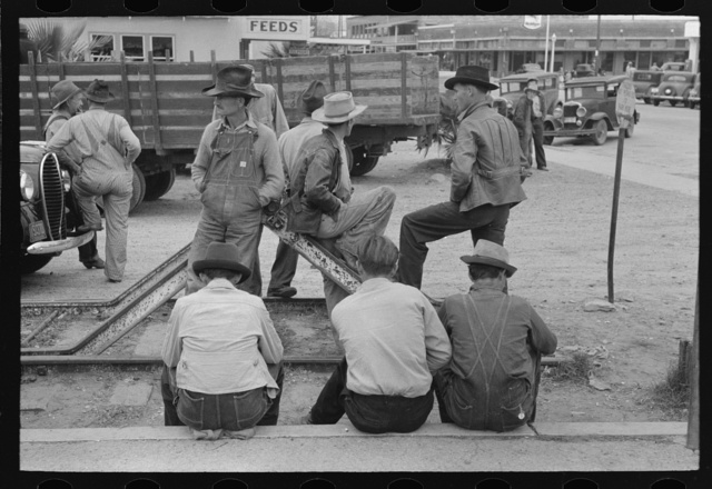 Day laborers waiting for possible assignment to work, early morning, Raymondville, Texas