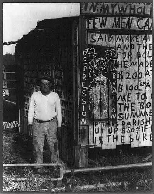 Delta Road, near New Orleans, La. Emile Riche, a farmer, has a small place bordering the levee, and for a period of years has been fighting the Parish officials for payments due him for damages to his property in the flood of 1927. He used this method of advertising by converting his barns and fences into a medium for visual statement