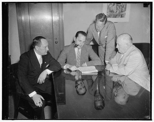 Department of Commerce. Left to right: Nathan D. Golden, Chief of Motion Picture Division of Bureau of Foreign and Domestic Commerce, Dr. Willard Thorpe, Economic Advisor to Secretary of Commerce Harry Hopkins, Ernest Tupper, Chief Statistician of Bureau of Domestic and Foreign Commerce, and Edward Kuykendall, Motion Picture Theater Owners of America