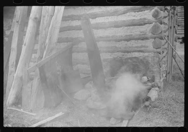 "Detail of house where tobacco is ""put in order."" A fire is built to make the tobacco moist and pliable. Fred Wilkins farm, Tally Ho, near Stem, Granville County, North Carolina"