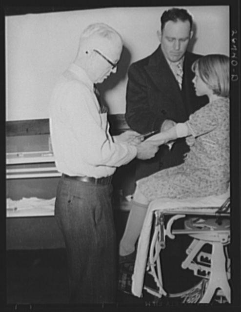 Doctor giving neoarsphenamine treatment under state program, combatting syphilis. Herrin Hospital, Herrin, Illinois