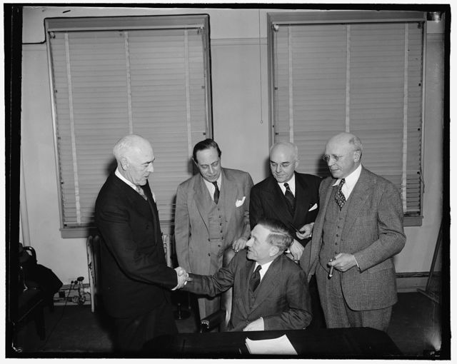 Douglas congratulated by SEC on nomination to Supreme Court bench. Washington, D.C., March 20. Fellow members of the Securities and Exchange Commission were the first to congratulate William O. Douglas, 40-year-old Chairman of the SEC., on his nomination to the U.S. Supreme Court by President Roosevelt today. He Succeeds Justice Brandeis, resigned. 3-20-39 Left to right - Robert E. Healy - Jerome Frank - Edward C. Eicher, and George C. Mathews.