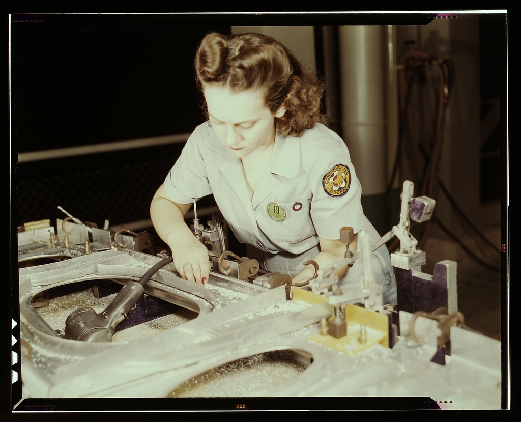 Drilling a wing bulkhead for a transport plane at the Consolidated Aircraft Corporation plant, Fort Worth, Texas