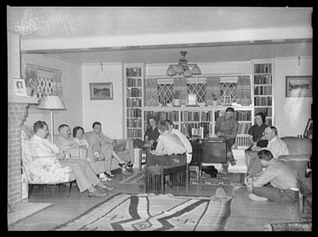 Dudes in living room of main house. Quarter Circle 'U' Ranch, Montana