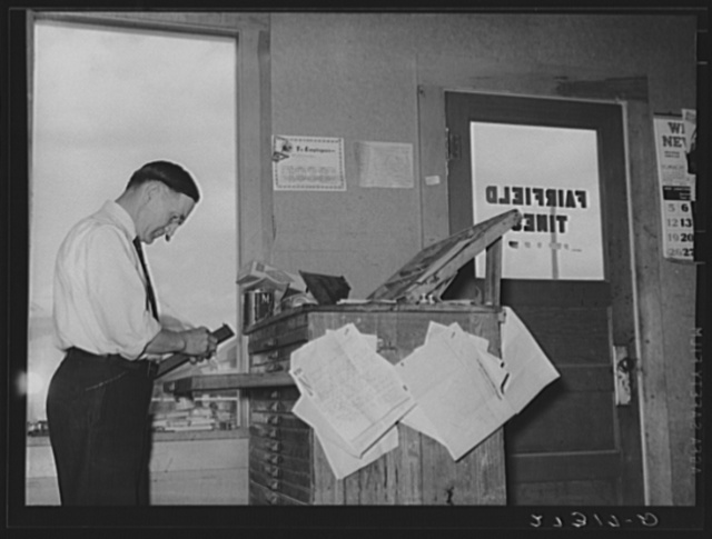 Editor of Fairfield Times setting type. Fairfield. Montana