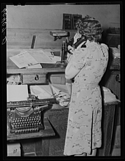 Editor of the Valley News getting news by telephone. Browns Valley, Minnesota