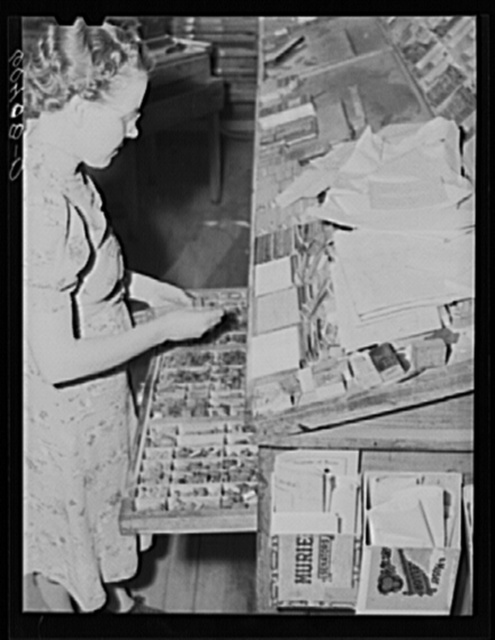 Editor of the Valley News picking out type. Browns Valley, Minnesota