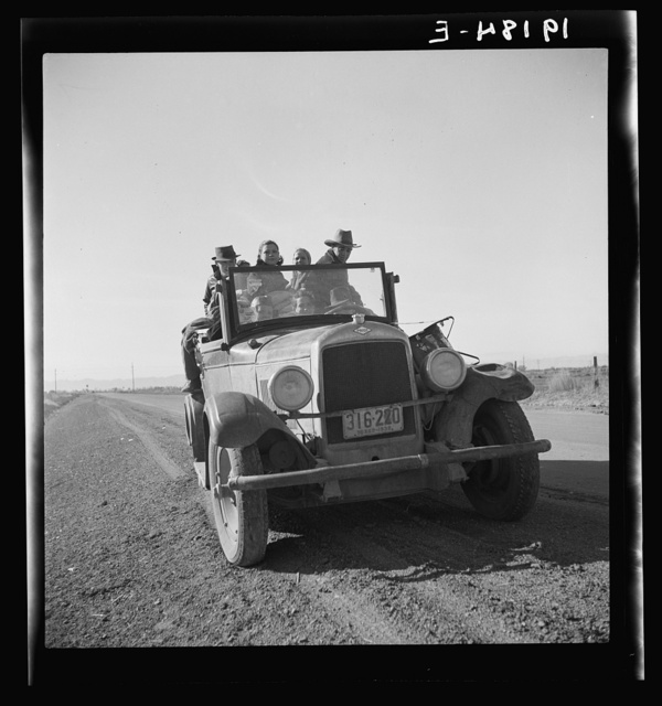 Eight related persons just arriving in this roadster from Texas. In search of employment as pea pickers. On U.S. 80. Imperial Valley, California