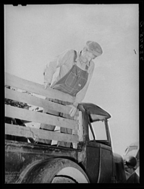Elmer Thomas, migrant to California, standing on the body of his improvised truck before leaving for California. Near Muskogee, Oklahoma