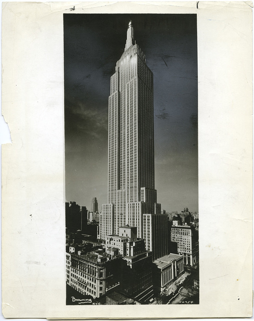 [Empire State Building in daytime with lights on]